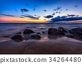Sea sunset seascape with wet rocks 34264480