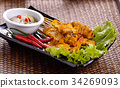 grilled pork satay in black plate 34269093