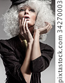 Cloe-up portrait of a pale, stylish lady 34270003