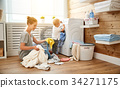 Happy family mother   housewife and children in   laundry load w 34271175