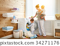 Happy family mother   housewife and children in   laundry load w 34271176