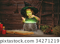 Halloween. little witch child cooking potion in   cauldron with 34271219
