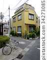 Yellow house and bicycle in Tokyo, japan 34273085