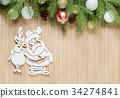 Santa and reindeer standing arm in arm 34274841