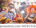 family celebrating Halloween 34291316