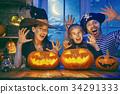 family celebrating Halloween 34291333