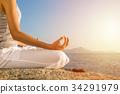 young woman meditation yoga pose on tropical beach 34291979