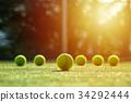 soft focus of tennis ball on tennis grass court  34292444