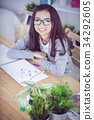 Portrait asian cute girl drawing at home. 34292605