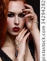 Beautiful vampire young woman 34294282