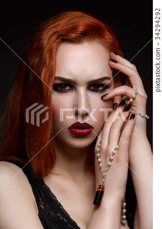 Beautiful vampire young woman 34294292