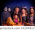 Halloween kids holding carved pumpkin . 34294812
