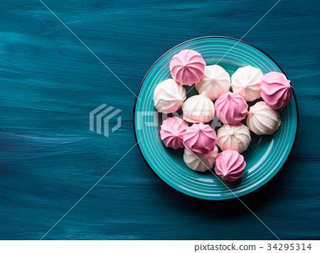 Pastel color meringue on green 34295314