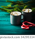 Hot chocolate on dark green. Christmas drink 34295334