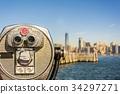 binoculars with blurred New York City  34297271