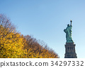 back of the statue of liberty with autumn foliage 34297332