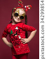 Funny little girl in the New Year's image, showing 34299854
