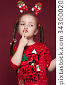 Funny little girl in the New Year's image, showing 34300020
