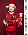 Funny little girl in the New Year's image, showing 34300080