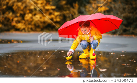 happy child girl   in   puddle  34300473