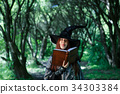 Photo of young witch with book 34303384