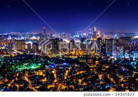Cityscape at night in Seoul, South Korea. 34305927