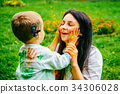 Happy mother and son playing with holi paints 34306028