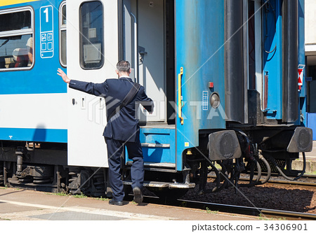 Train conductor at the station 34306901