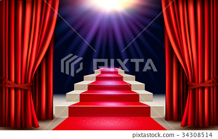 Showroom with red carpet leading to a podium 34308514