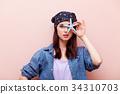 Young redhead girl in bandana holding starfish 34310703