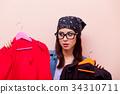 Young redhead girl designer in bandana  34310711