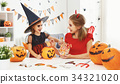 happy family  in costumes for halloween 34321020