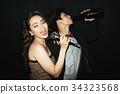 Drunk couple singing 34323568