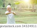 Senior man practicing tai chi outdoor 34324911