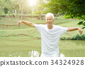 Old man practicing qigong in the park 34324928