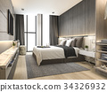 luxury modern bedroom suite in hotel with wardrobe 34326932