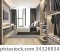 luxury modern bedroom suite in hotel with wardrobe 34326934