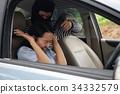 robber man point  gun at car owner 34332579
