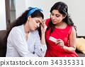 Woman giving medication against headache 34335331