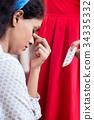 Woman giving medication against headache 34335332