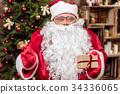 Cheerful old Santa Claus celebrating favorite 34336065