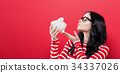 Young woman with a piggy bank  34337026