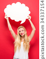 Young woman holding a speech bubble  34337154