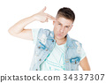 young man in denim isolated white background 34337307