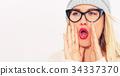 Young woman shouting 34337370