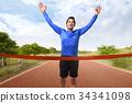 Asian man running crossing the finish line 34341098