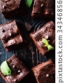 Dark chocolate brownies on dark background 34346856