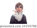 Boy in scary Hallowe'en costumes isolated on white 34350786