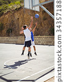 Full length of basketball players practicing in court 34357188