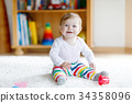 Adorable baby girl playing with educational toys 34358096